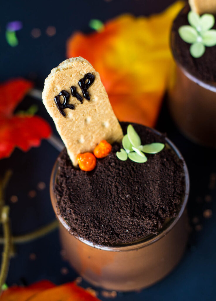 chocolate pudding cup with graham cracker tombstone