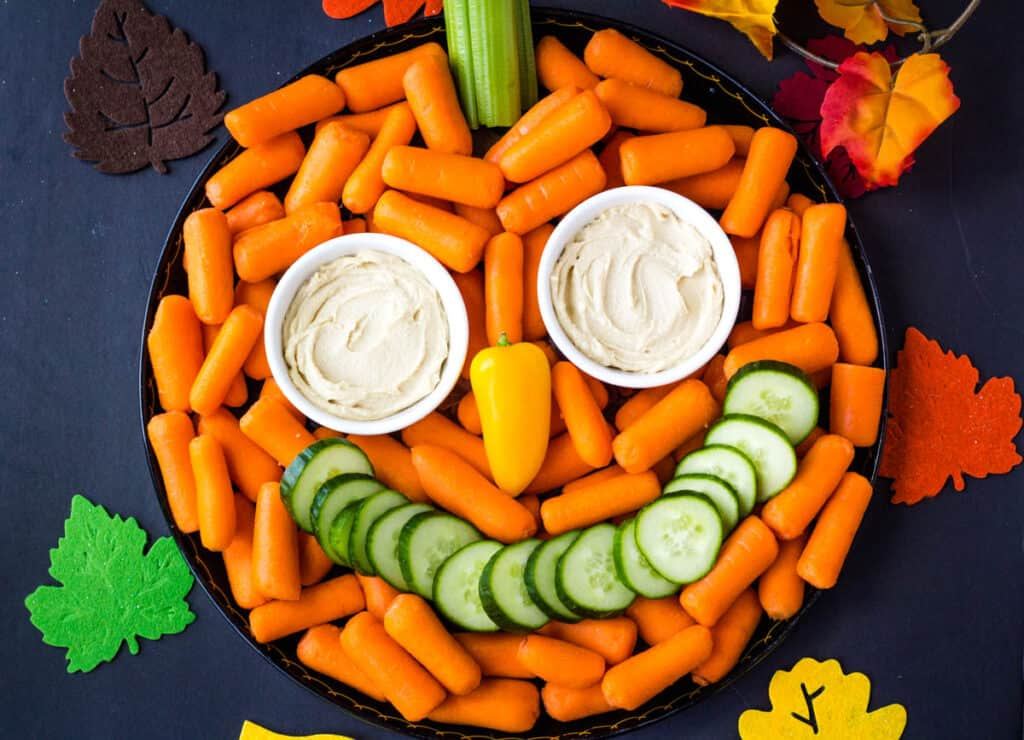 pumpkin veggie tray with carrots and cucumbers