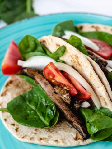 vegan bao buns with mushrooms, spinach, onion, and tomato