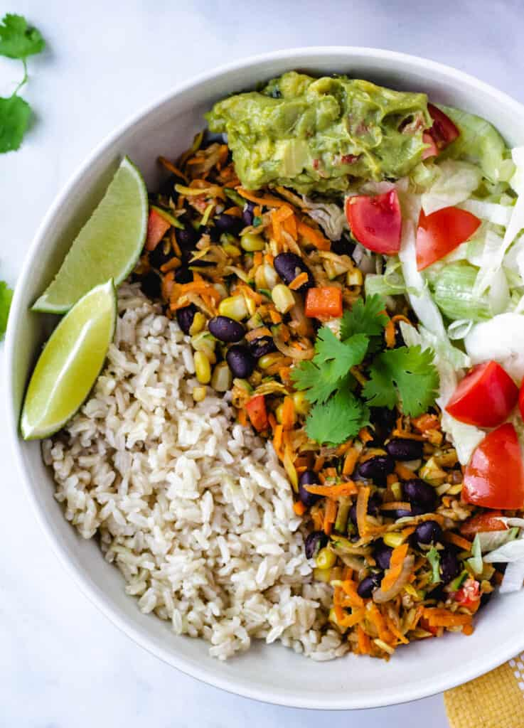 vegan burrito bowl with wedge of lime