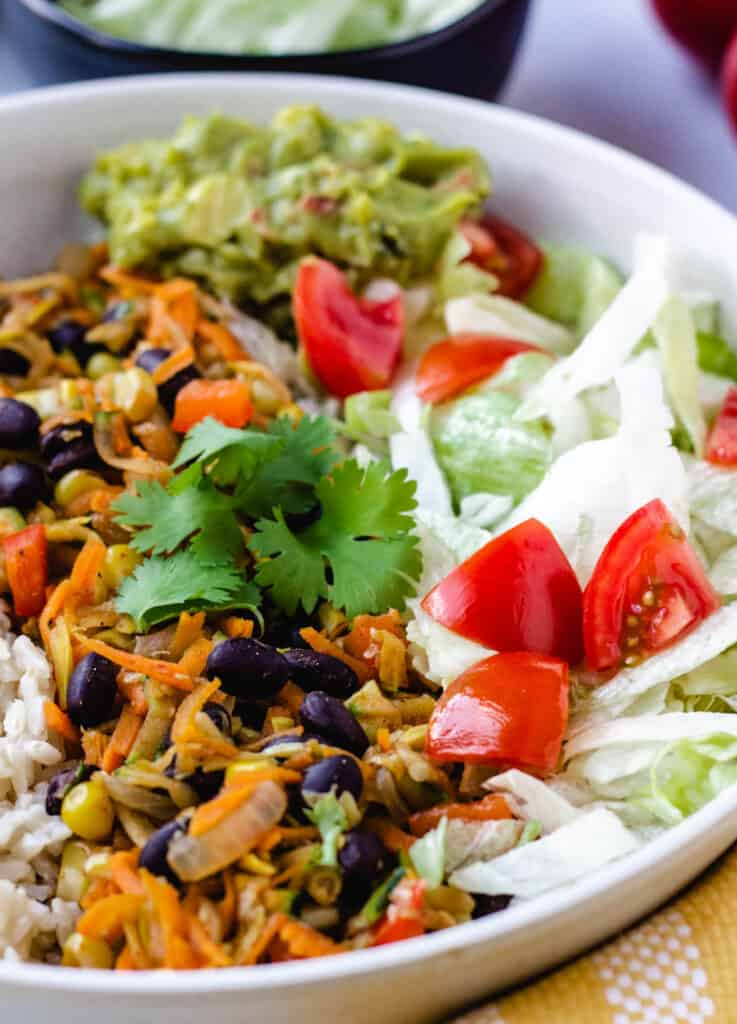 close up of vegan burrito bowl topped with cilantro