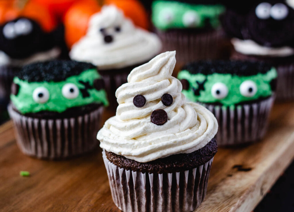 ghost cupcake with monster cupcakes in background