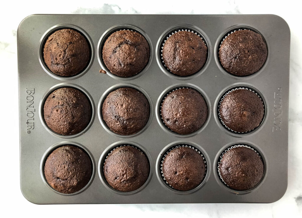 baked chocolate cupcakes in cupcake tin