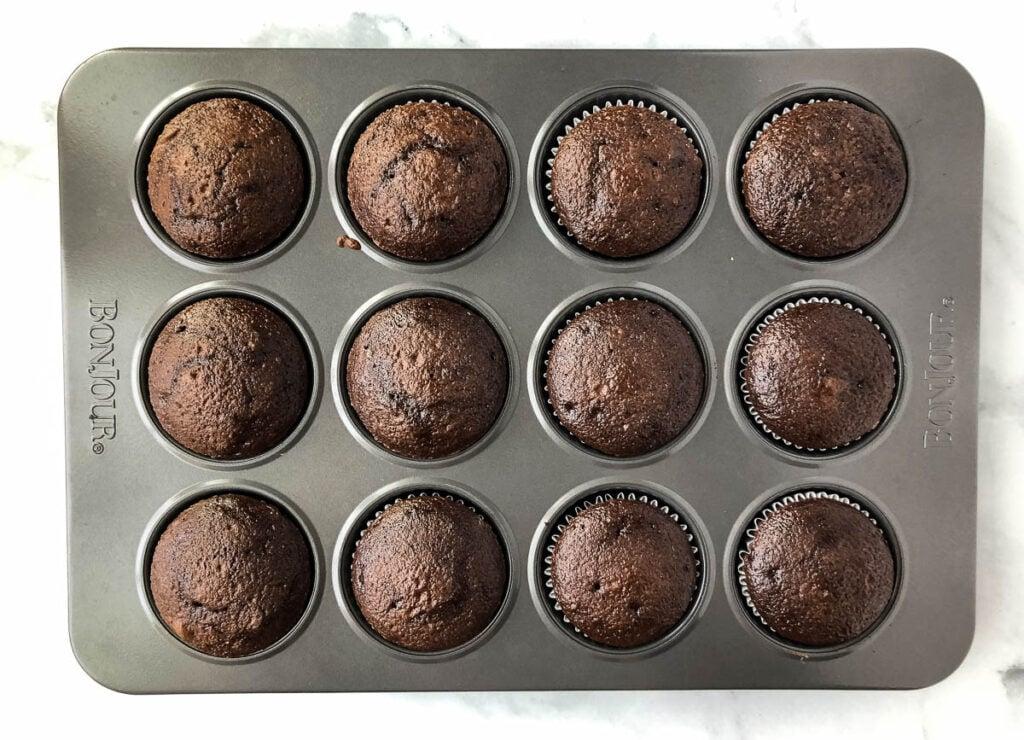 baked chocolate cupcakes in cupcake tin