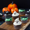 halloween cupcakes, a ghost, monster, and bat