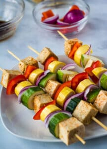 vegan kebab skewers before grilled on white plate