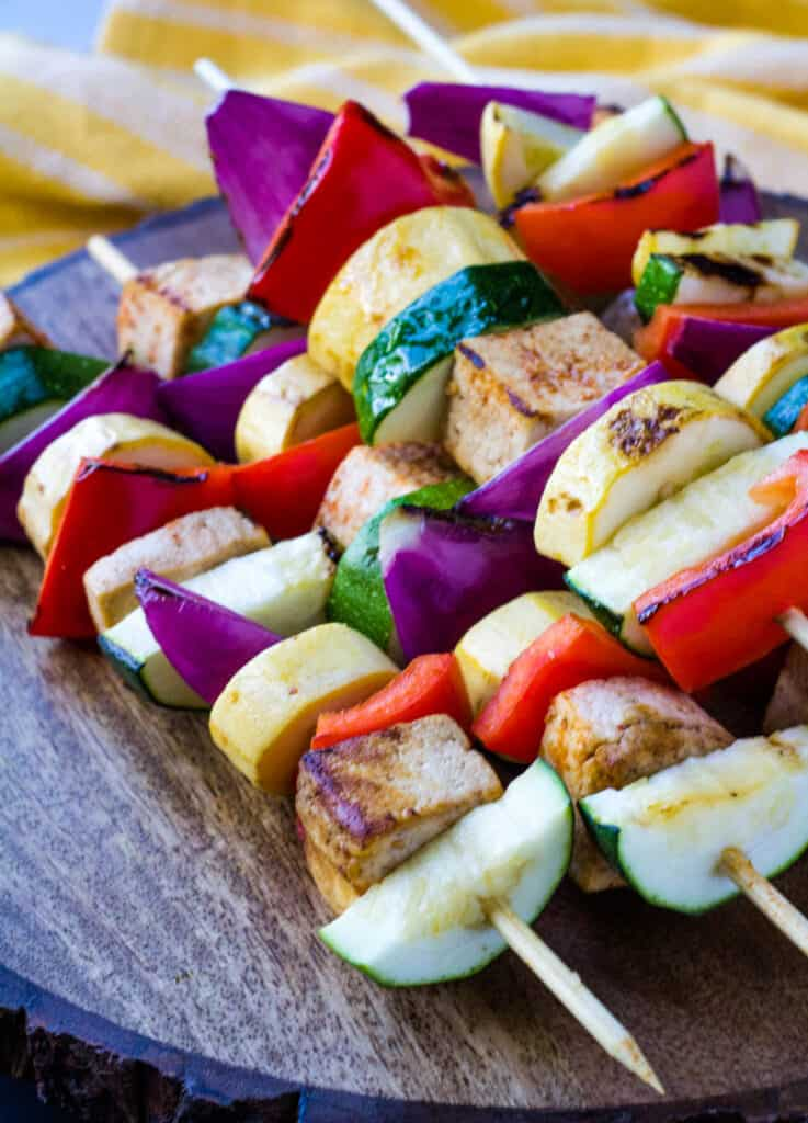 grilled tofu kebab on wood serving platter