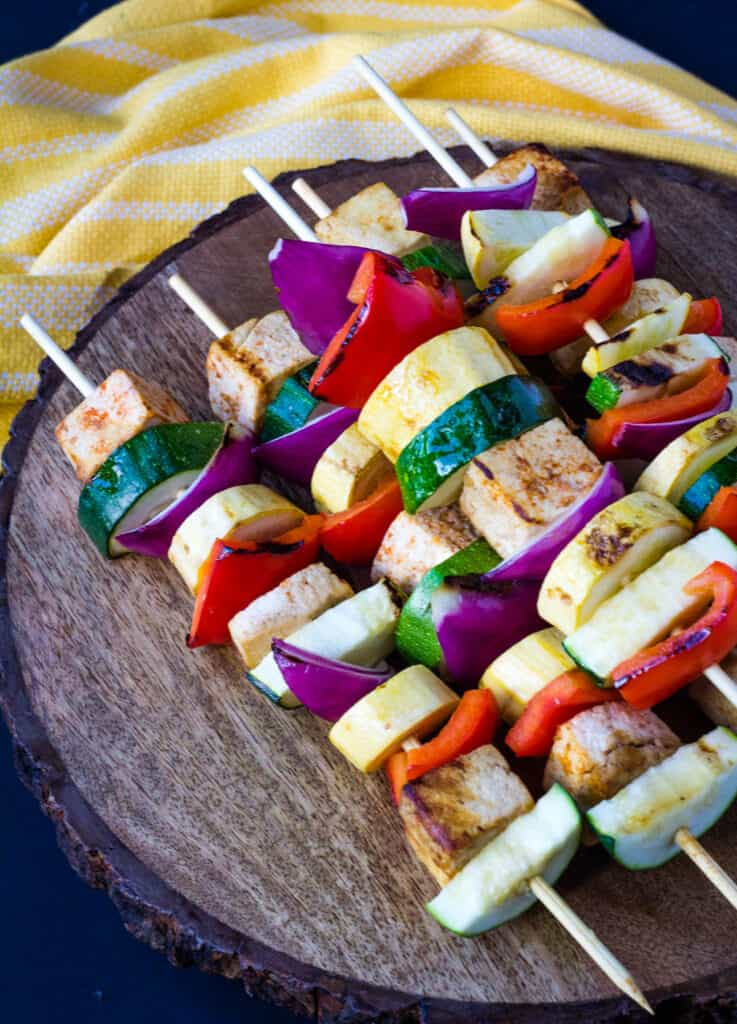 tofu and vegetable kebabs in wood platter