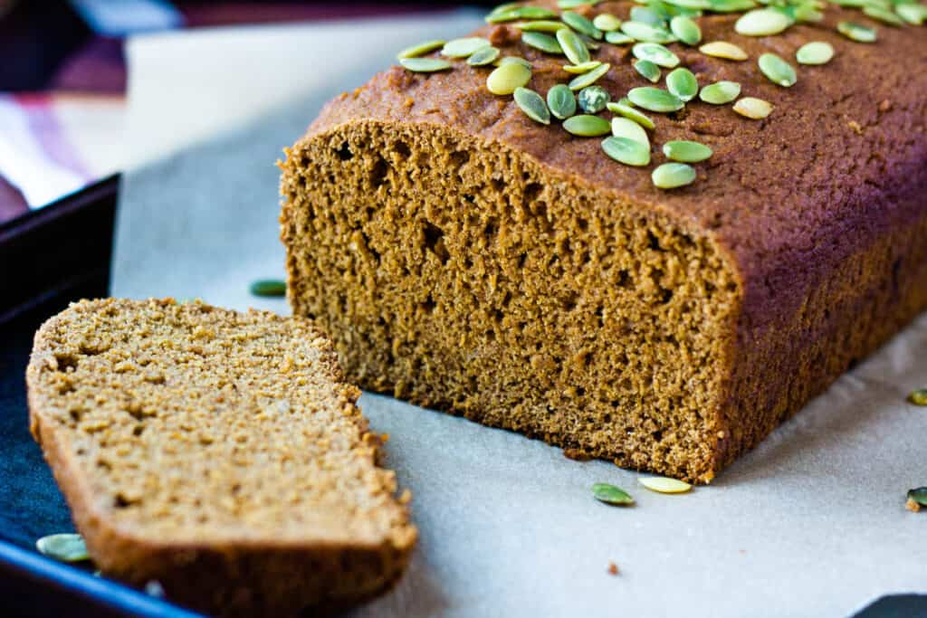 pumpkin bread loaf with slice cut off the end