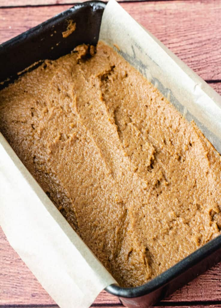 pumpkin bread batter in 9 inch loaf pan