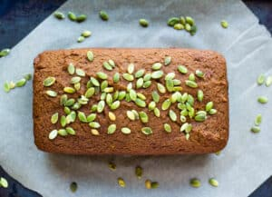 pumpkin bread loaf topped with pumpkin seeds