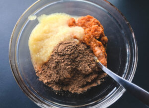 pumpkin puree, applesauce, and spice in bowl