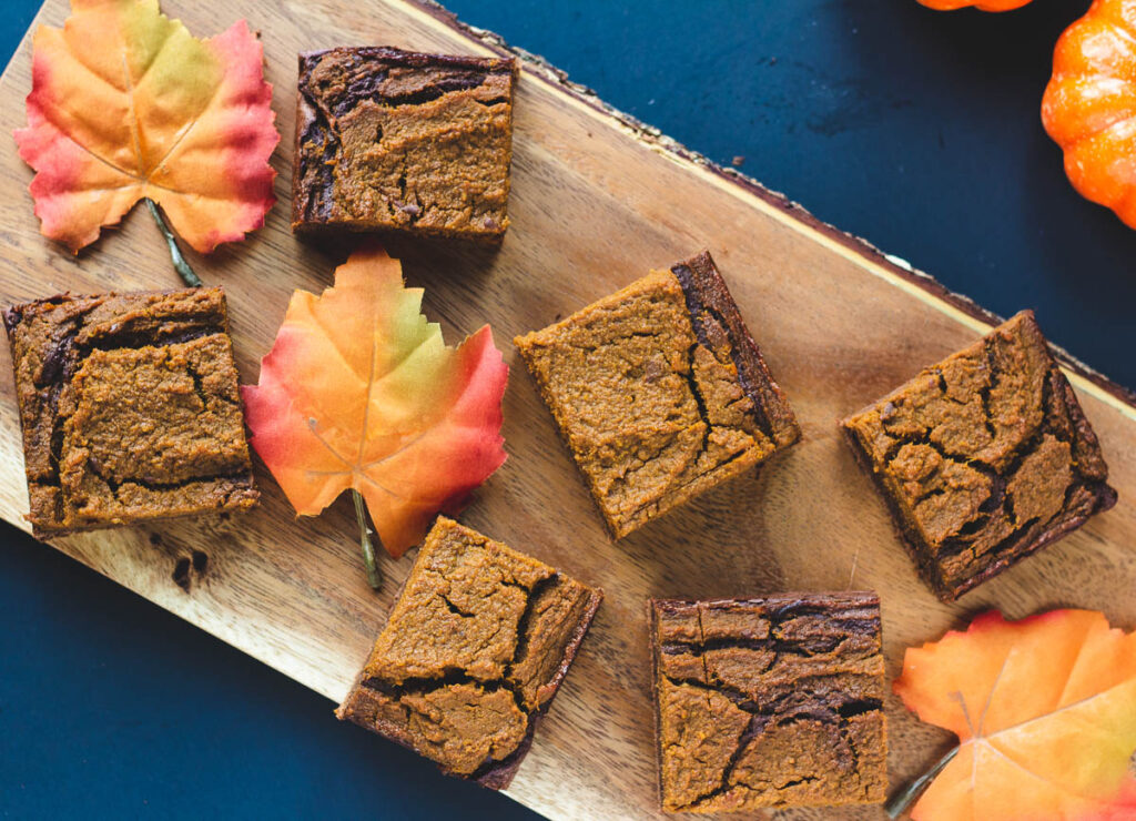 vegan pumpkin brownies on wood serving tray