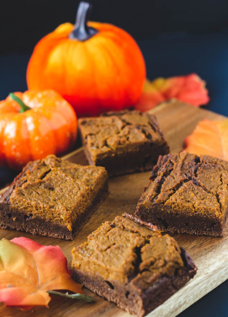 vegan pumpkin brownies on wood serving plate