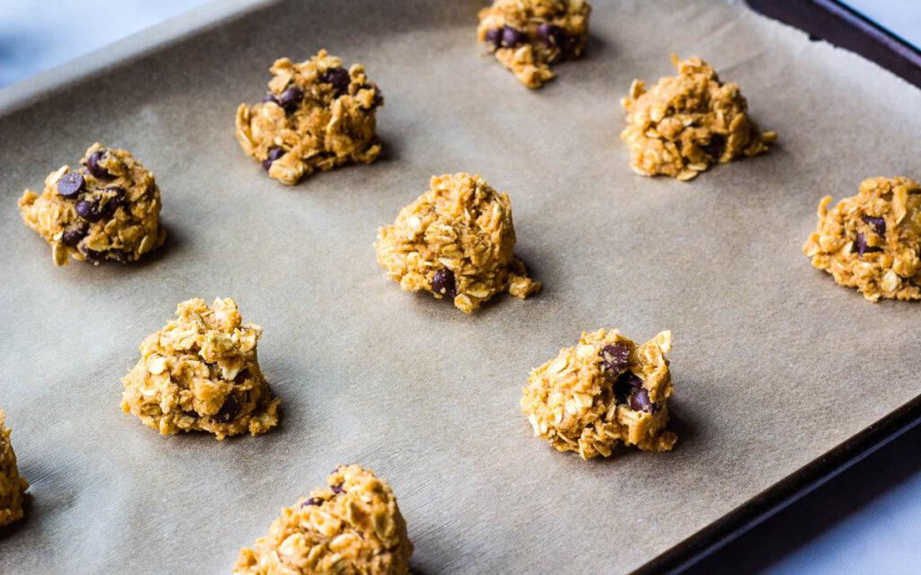 cookie dough balls on baking sheet