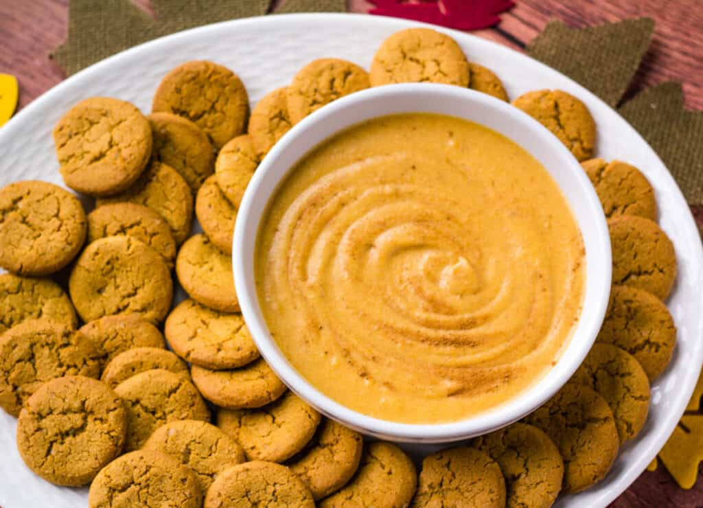 pumpkin dip with gingersnap cookies on platter