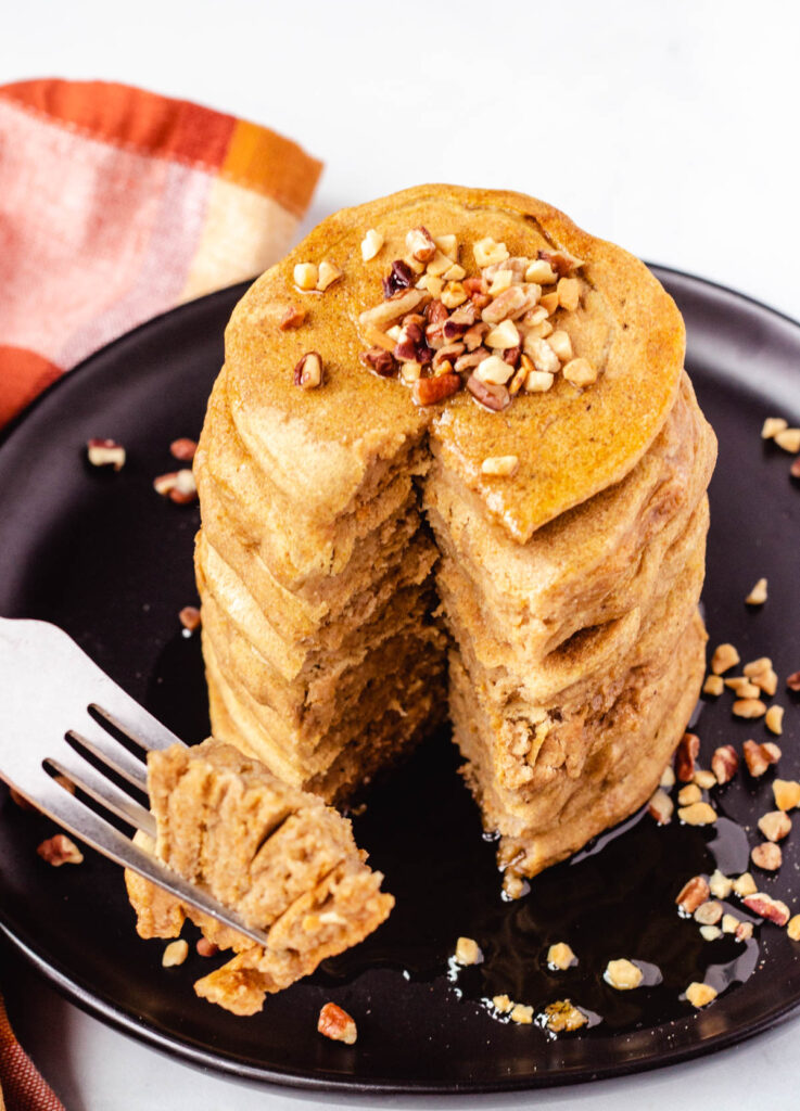 stack of vegan pumpkin  pancakes with a bite cut out