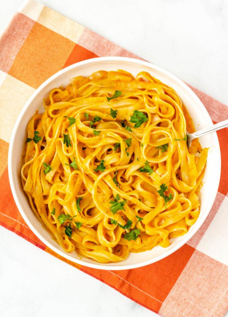 vegan pumpkin pasta in white bowl