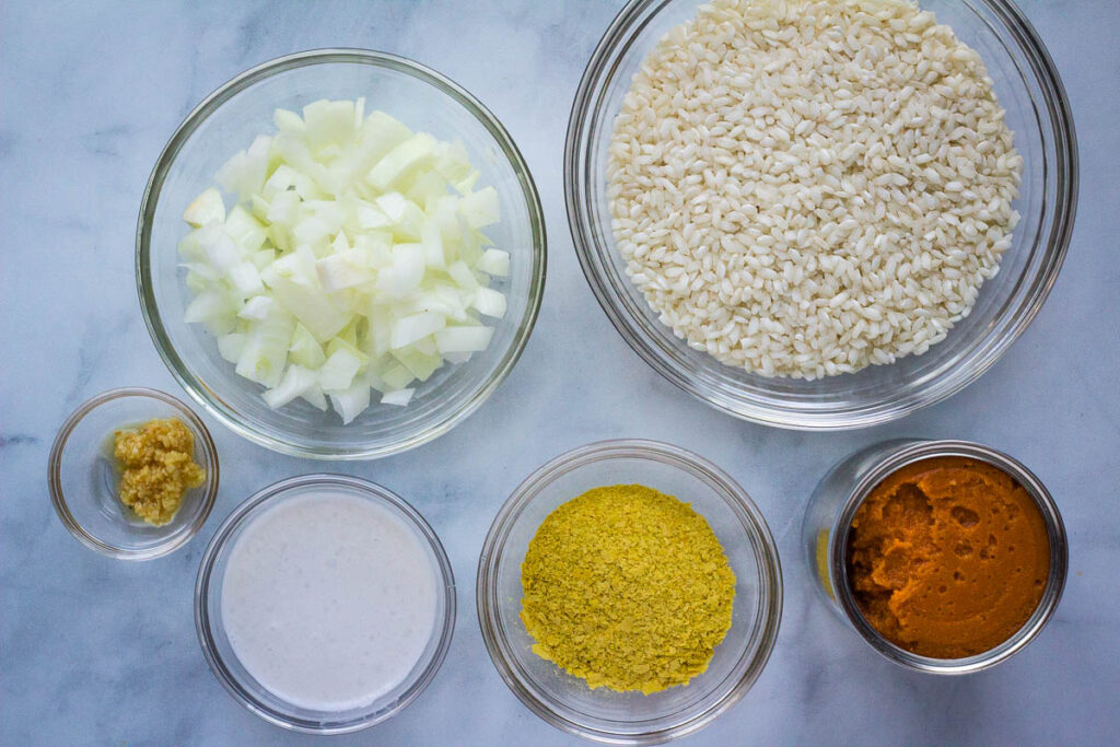 vegan pumpkin risotto ingredients in individual bowls