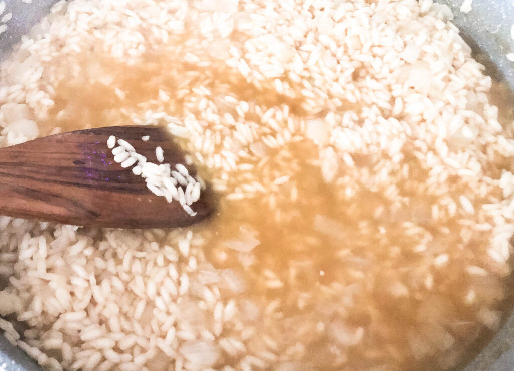 arborio rice and stock in pot