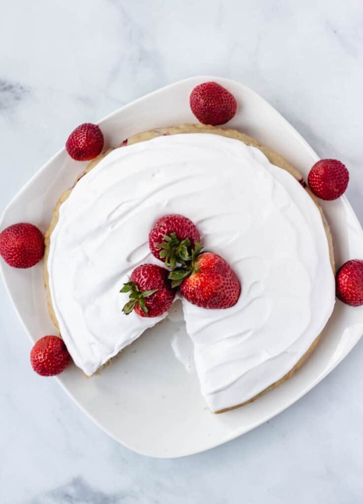 overhead vanilla cake topped with strawberries