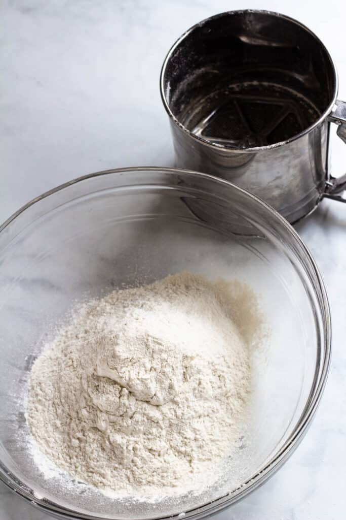 sifted flour in glass bowl