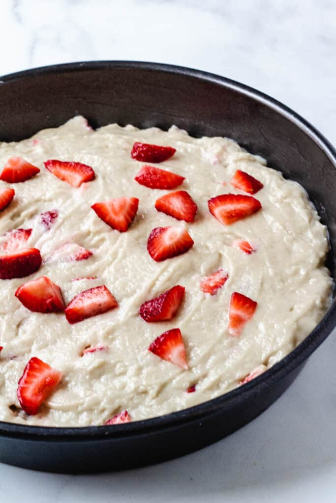 strawberry cake batter in pan