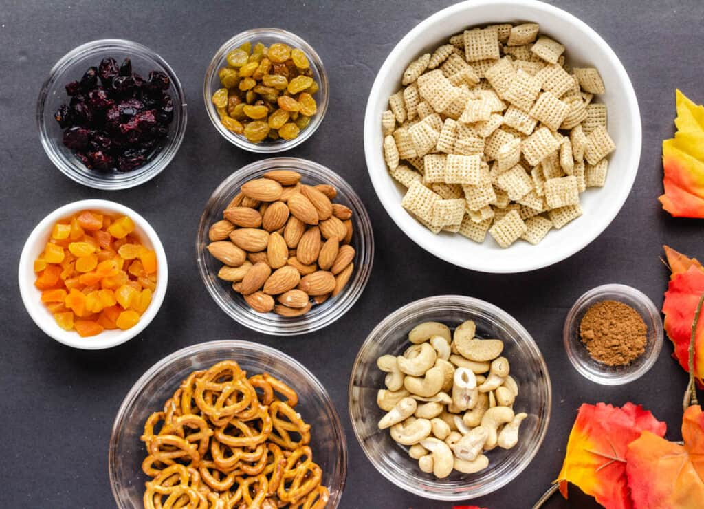 ingredients for vegan trail mix in small bowls