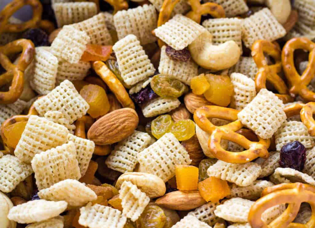 close up of snack mix with pretzels and chex