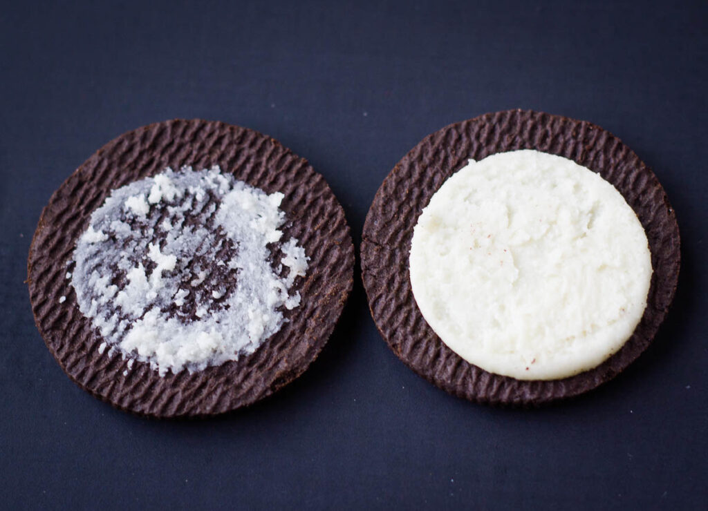 two halves of an chocolate cream cookie