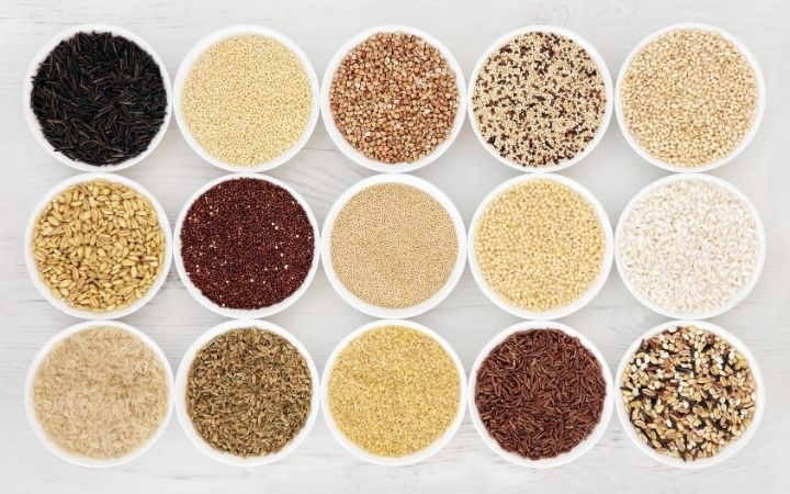 a variety of grains in small white bowls