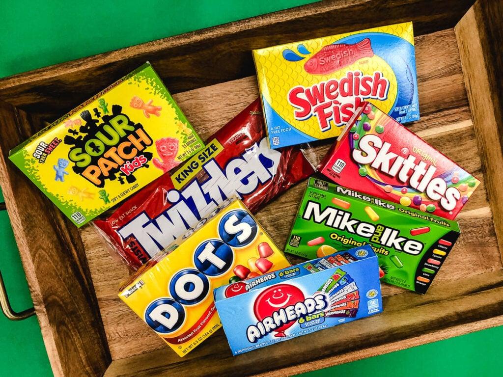 assorted vegan halloween candy on wood tray