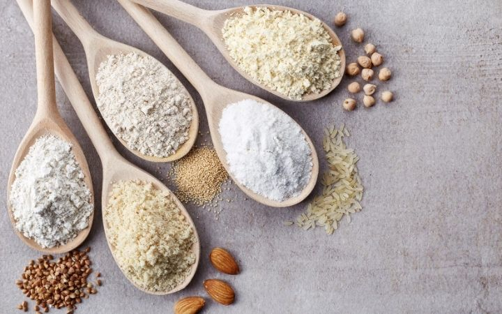 gluten free flours on wooden spoons