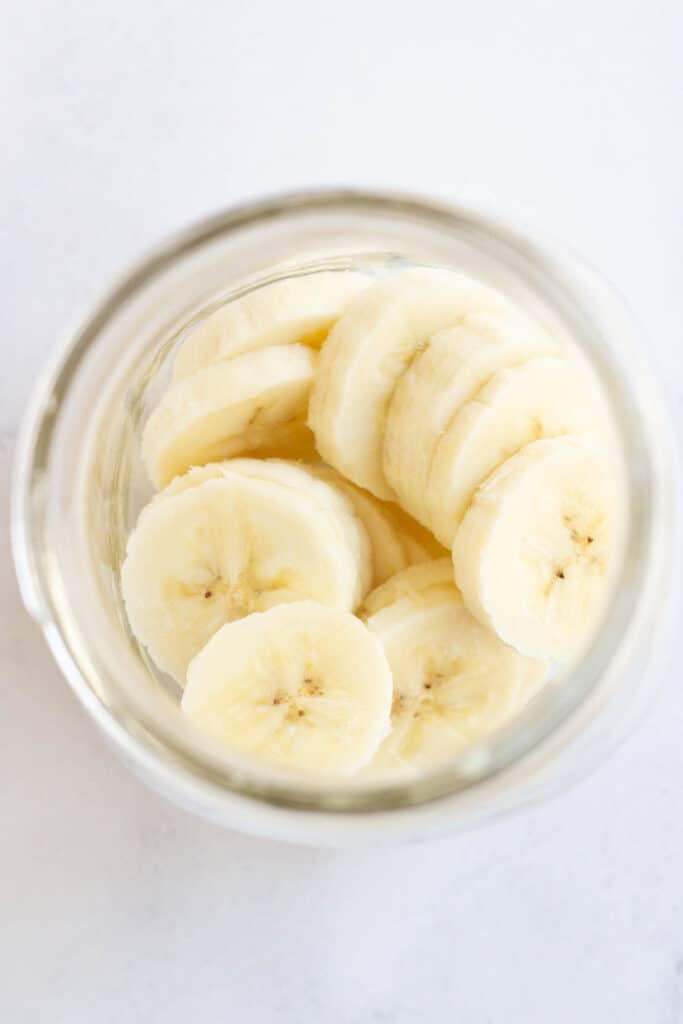 banana slices on bottom of mason jar