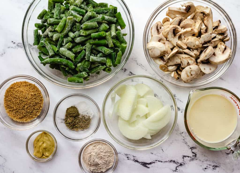green beans, mushrooms, onion, soy milk, and spices in glass bowls