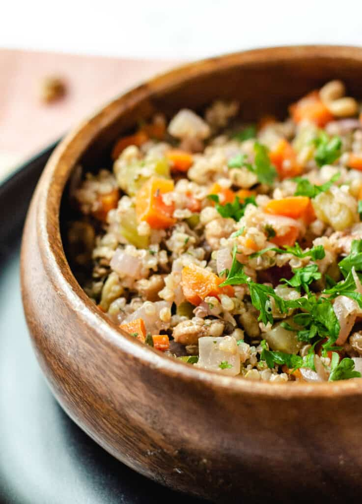 quinoa with vegetables in wood bowl