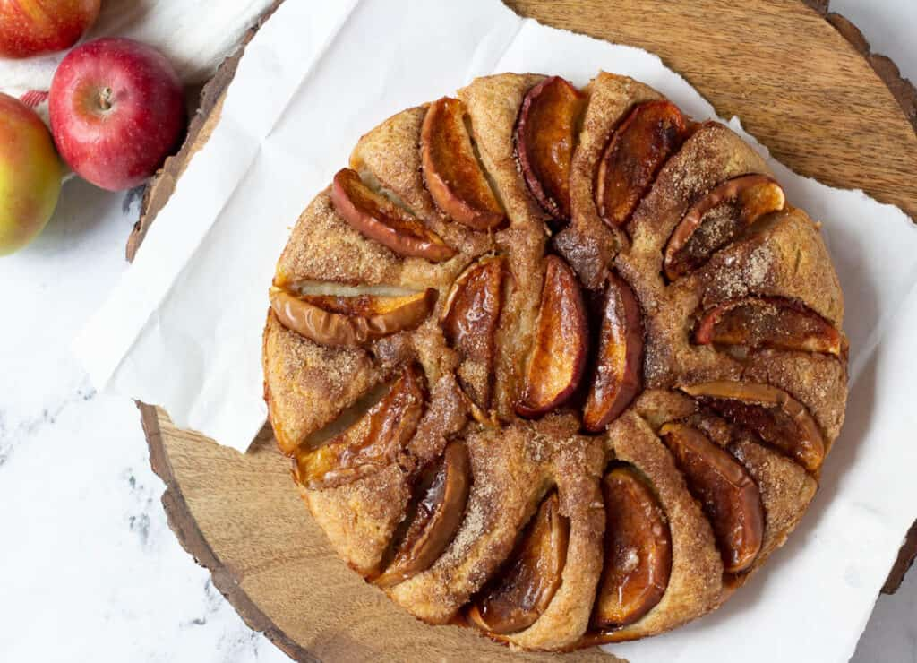 overhead of apple cake on wood serving platter