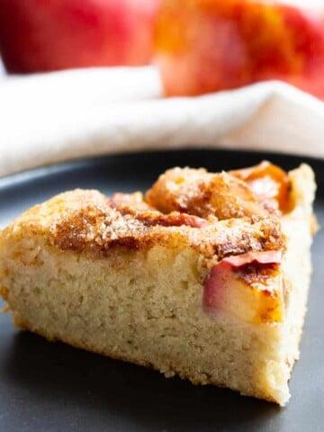 slice of vegan apple cake on black plate