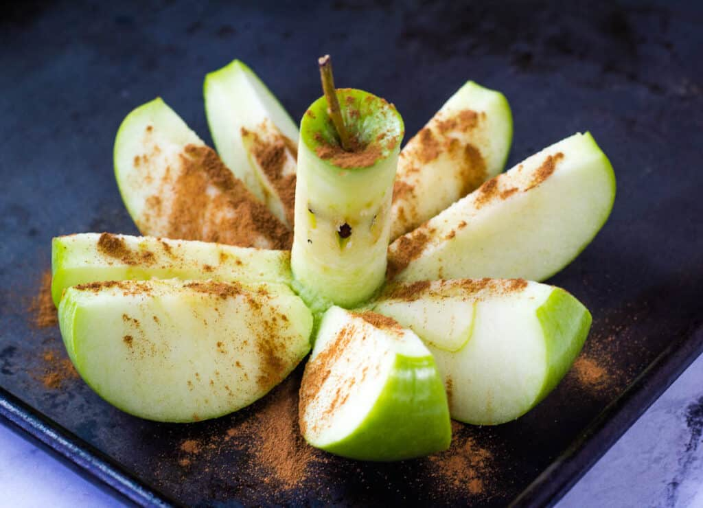 apple cored and sprinkled with cinnamon