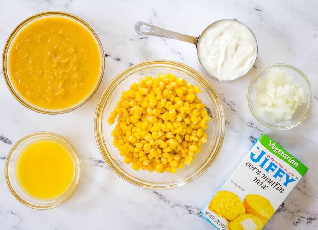 corn, creamed corn, butter, cornbread mix, onions, and yogurt on countertop