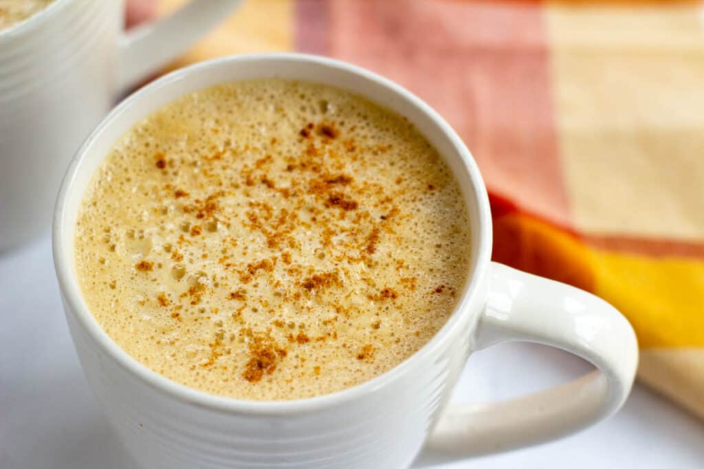 vegan pumpkin spice latte in white mug