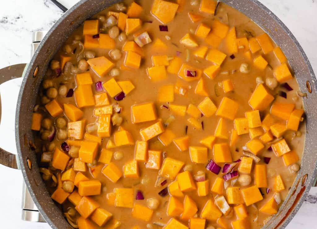 butternut squash and onions in curry sauce before it's cooked