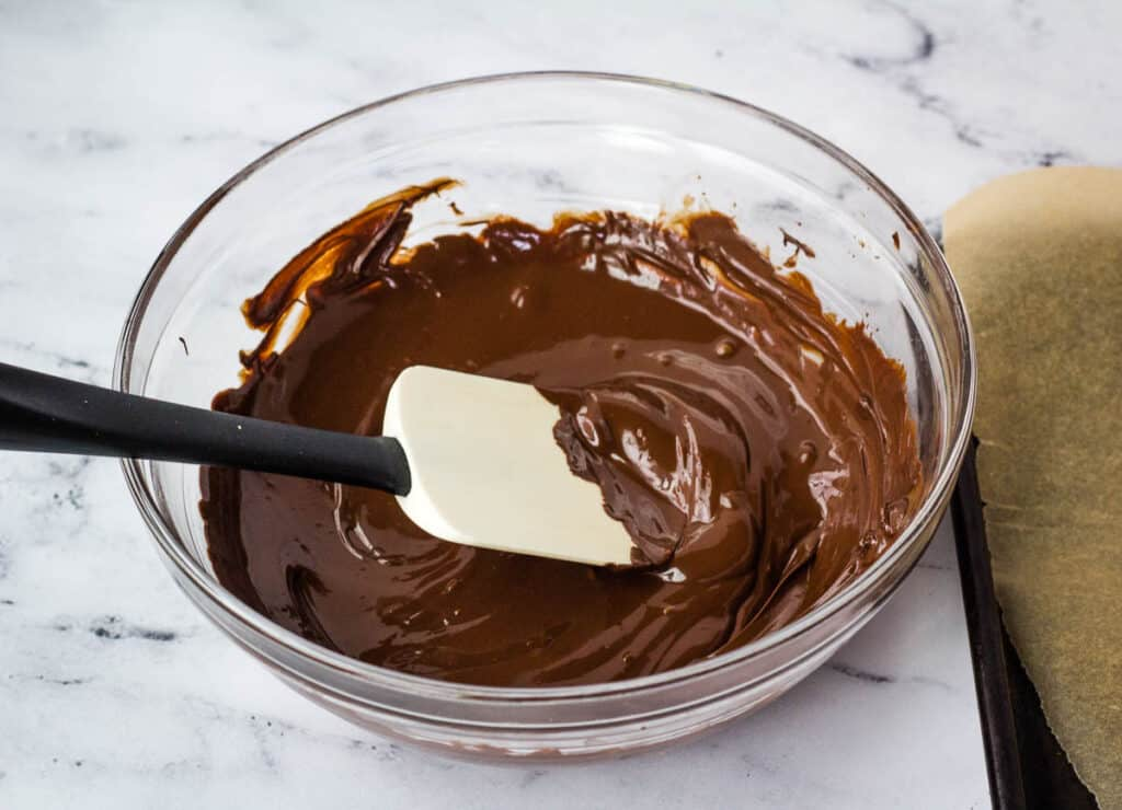 melted dark chocolate in glass bowl