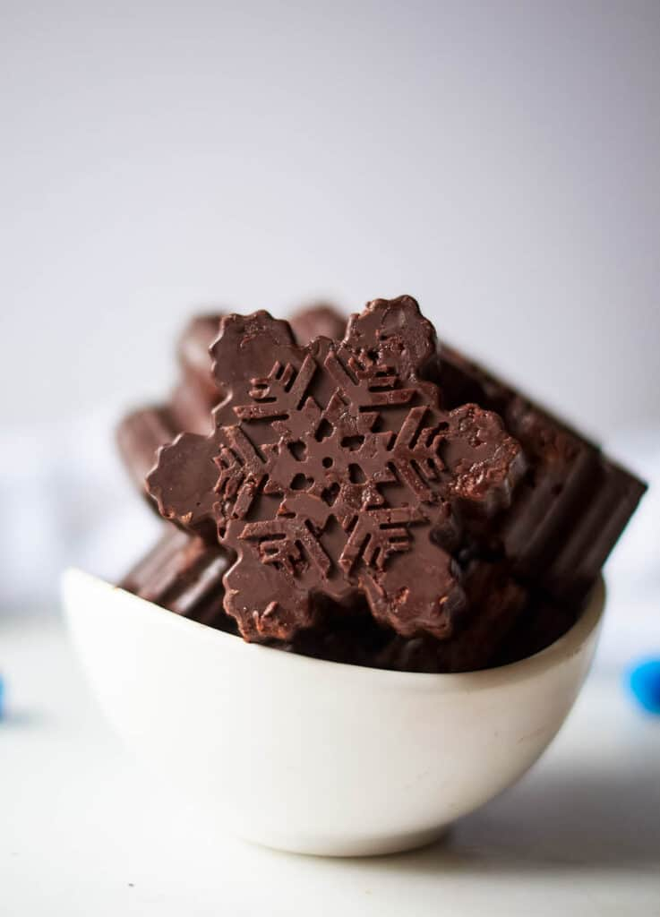 chocolate snowflakes in white bowl