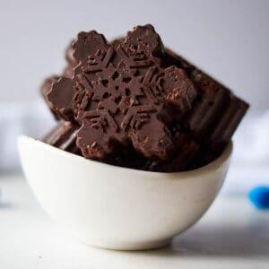 dark chocolate snowflakes in white bowl