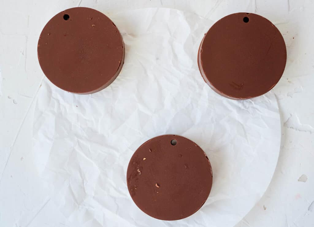 chocolate disks on white parchment paper
