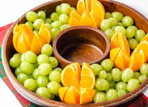 oranges and grapes on round tray