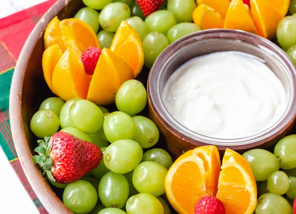fruit platter with grapes oranges and strawberries with yogurt dipping sauce