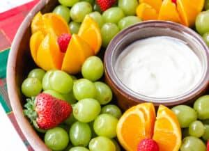 yogurt sauce and fruit on tray