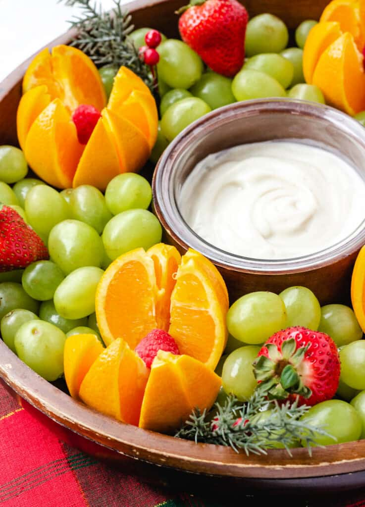 vanilla dairy free yogurt surrounded by fruit